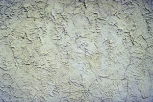 how to paint interior stucco walls